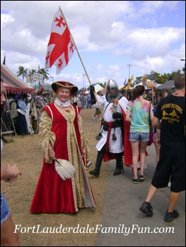 Renaissance Festival performers as a lady and her brave knight.