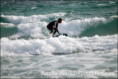 Surfing the waves at Deerfield Beach