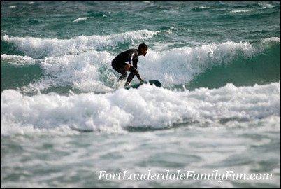 Surfing the waves at Deerfield Beach